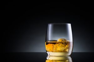 Melting ice in a glass of whiskey